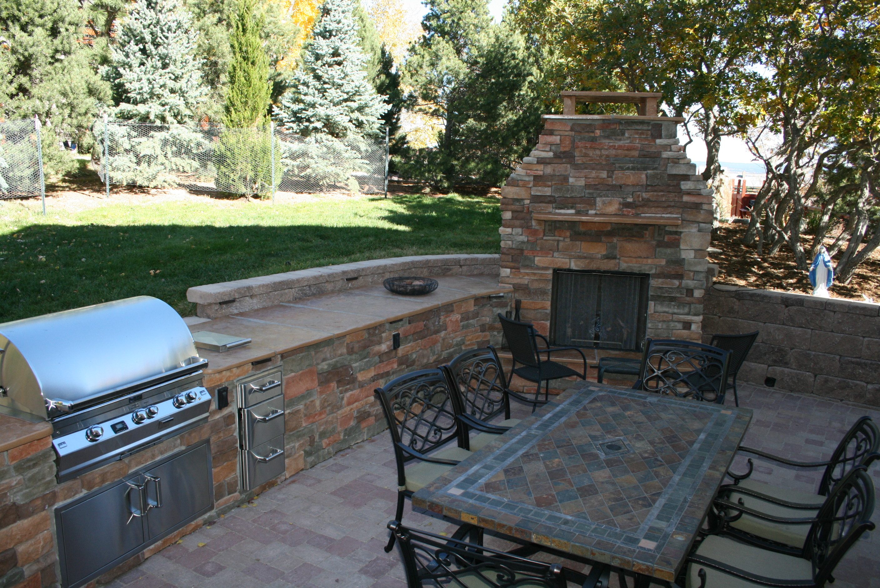 Outdoor kitchen installation outdoor fireplace designs for Outdoor fireplace kitchen designs